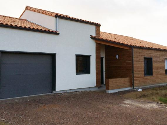 construction d'une maison ossature bois ( enduit et bardage bois